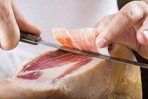 Professional cutting of serrano ham