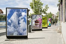 billboards with photographs at city