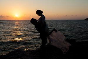 Silhouette of couple by the sea
