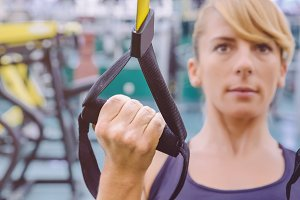 Fitness strap in the hand of woman