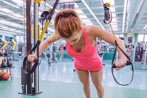 Woman doing suspension training