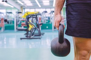 Man holding kettlebell in a crossfit