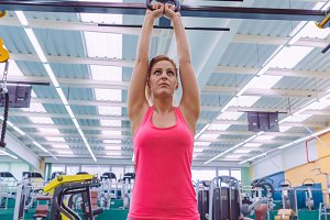 Woman lifting kettlebell in a gym