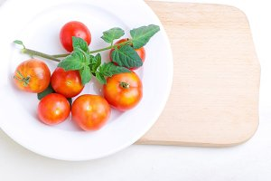 tomatoes on a plate background