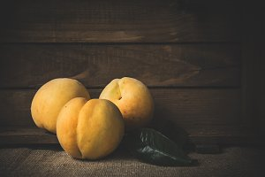 Fresh peaches on wooden board