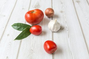 Fresh tomatoes on wooden board