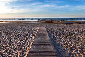 Wooden footpath to the sea