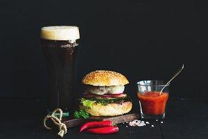 Fresh homemade burger and dark beer
