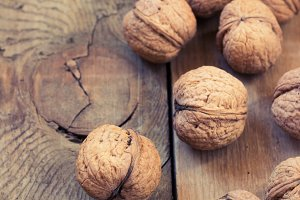 Pile of walnuts  on a wooden background