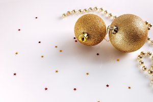 Two golden balls and pearls top