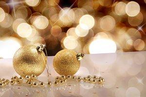 Two golden balls and golden bokeh