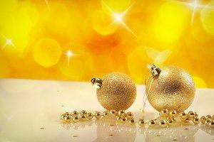 Two golden balls, pearl,yellow bokeh