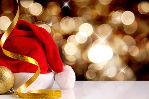 Santa Claus hat with golden bokeh