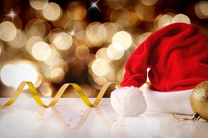 Santa Claus hat golden bokeh front