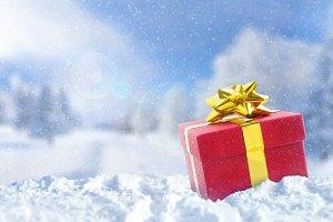 Gift box on snow at Christmas