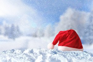 Santa Claus hat on snow at Christmas