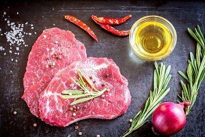 Fresh beef steaks with ingredients