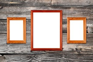 Three empty photo frames on wall