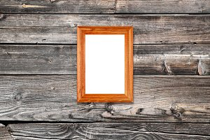 Blank photo frame on old wooden wall
