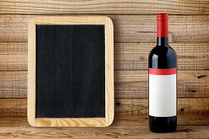 Bottle of red wine and blackboard