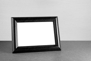 Vintage photo frame on table