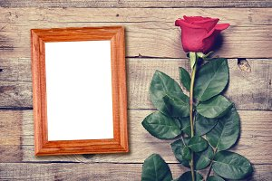 Vintage rose and blank photo frame