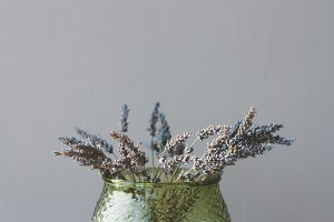 Dried lavender in a green vase