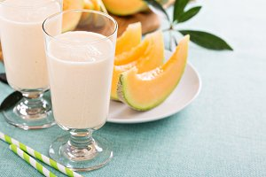Healthy cantaloupe smoothie on blue