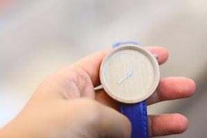 Hand holding wood wristwatch