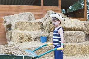 boy farmer at the barn