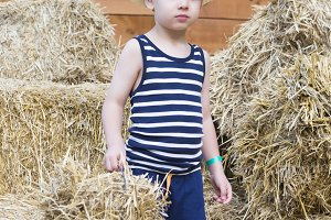 farm boy at the barn