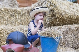young farm boy at the barn