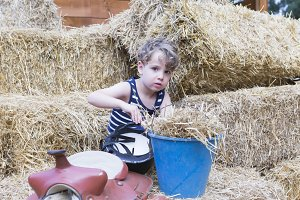 young rider in the hay bales