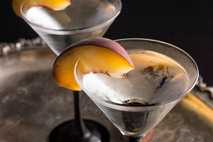 Cocktail with fresh peaches