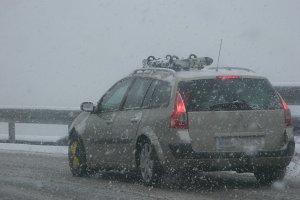 Car driving durin heavy snowfall