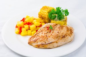 Food on plate: chicken and salsa