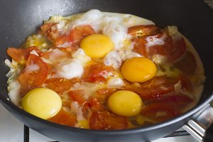 Scrambled eggs with red tomatoes and
