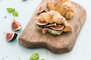 Freshly baked croissants with figs