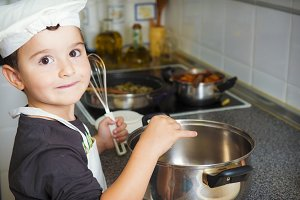 Little chef cooking in the kitchen