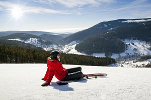 Female skier lying on snow