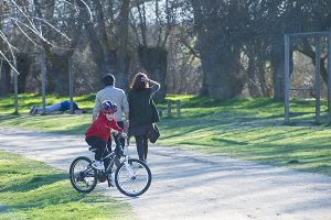 Child riding bike in a park