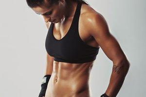 Woman bodybuilder resting after work