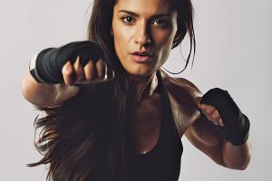 Hispanic female practicing boxing