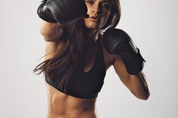 Female athlete exercising boxing