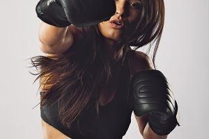 Hispanic female boxer practicing