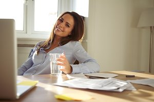 Woman working in home office smiling