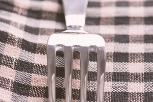 Fork on a checkered napkin