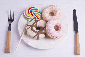 Multicolored lollipop with donuts