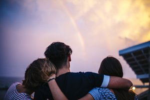 looking at the rainbow at sunset
