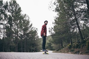 Man riding on a longboard